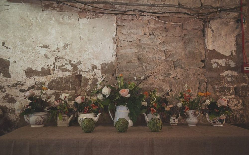 Shabby chic brick wall and flowers at Lyde Court weding venue in Herefordshire