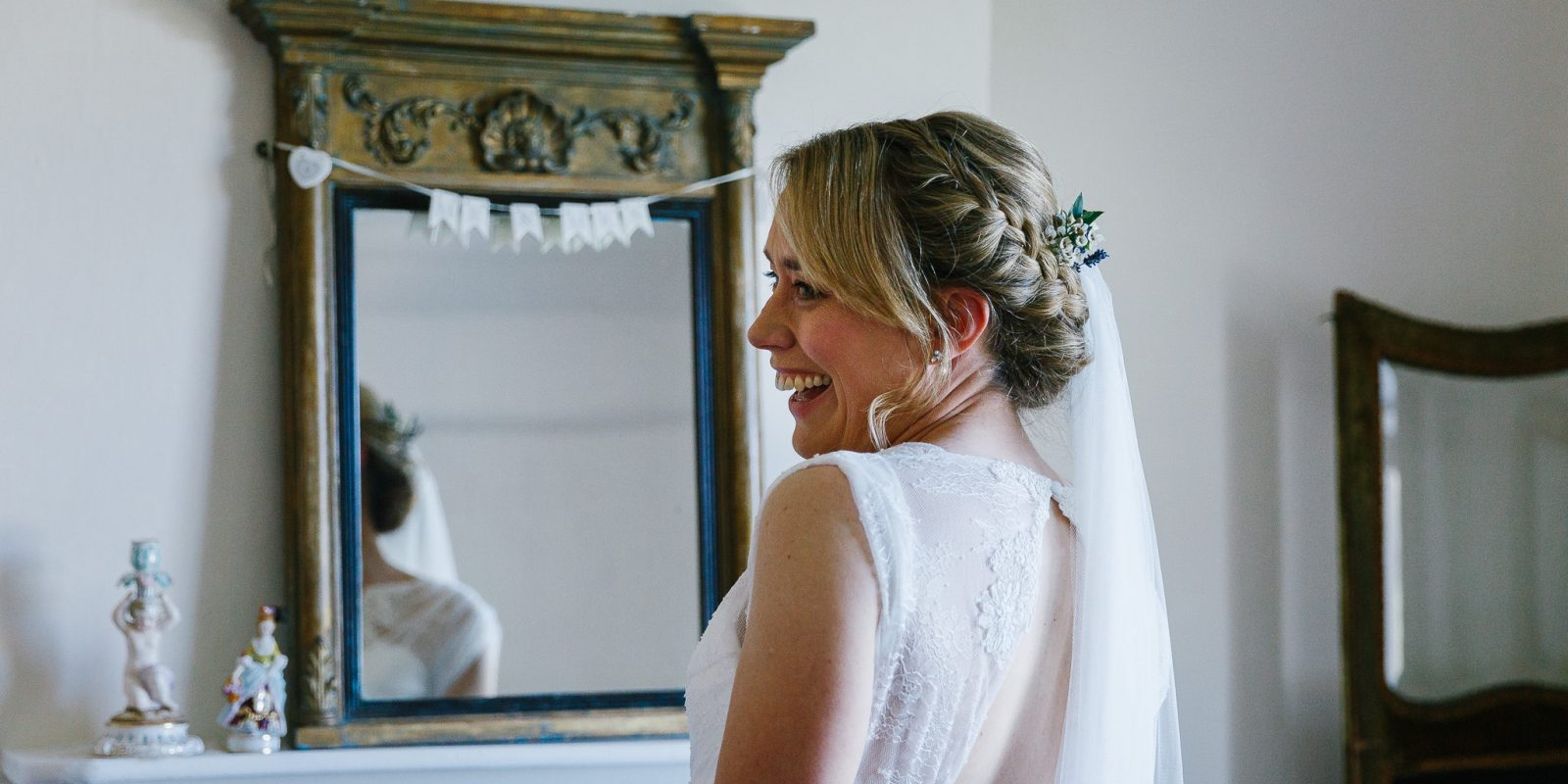 Bride in the bridal suite at Lyde Court Wedding Venue