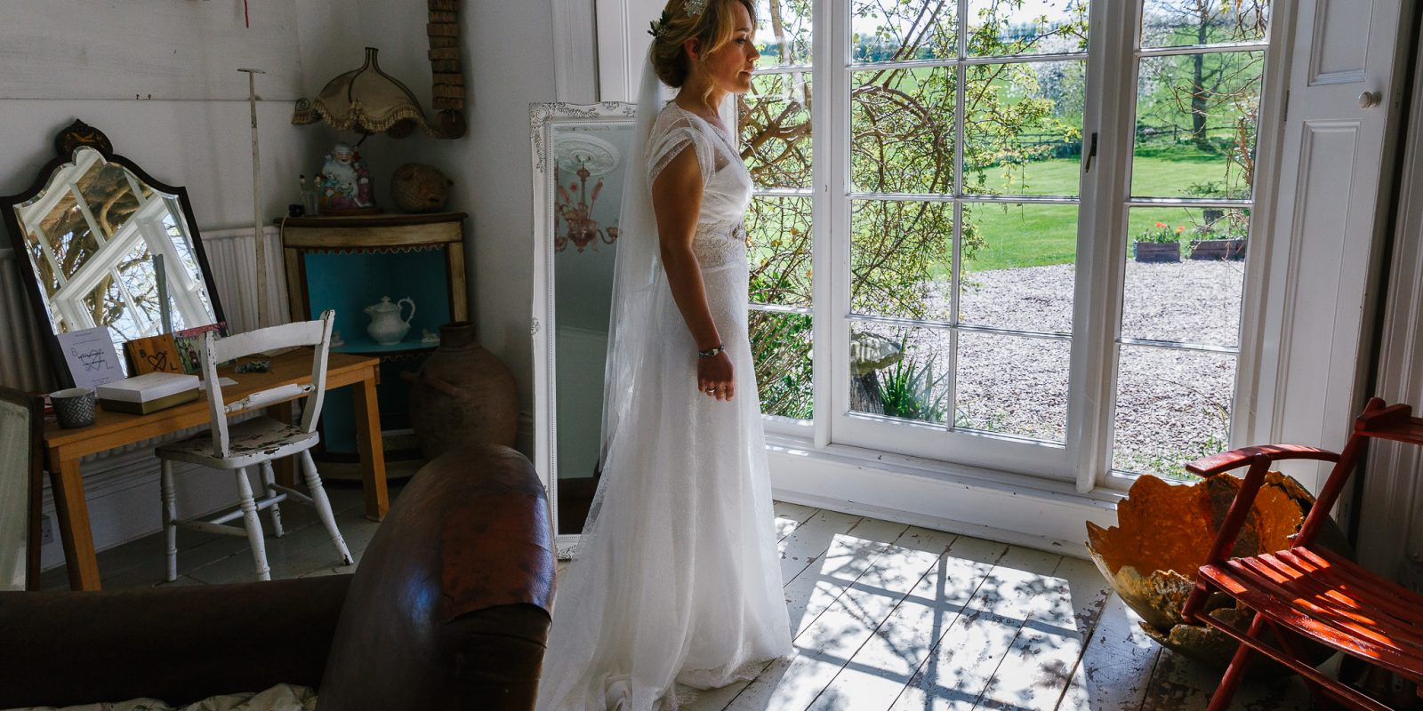 Bride in The White Room at Lyde Court Wedding Venue
