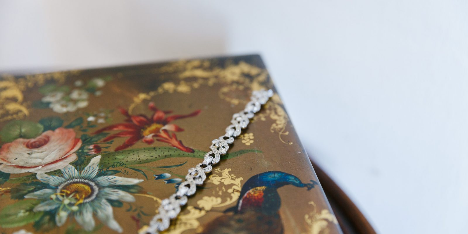 Jewellery on a vintage box at Lyde Court wedding venue