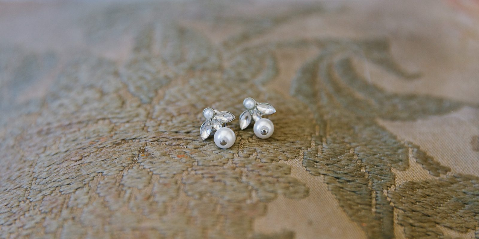Earrings on vintage tapestry at Lyde Court wedding venue