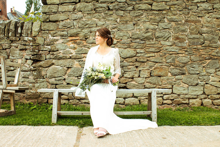 Lonely bride at Lyde Court Barn Wedding Venue, Hereford