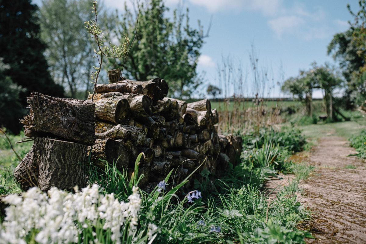 log pile at Lyde Court barn wedding venue